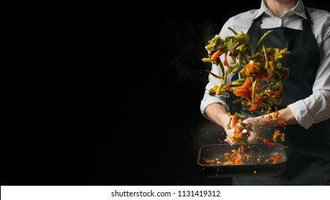 The chef prepares. Black background for copy text.Concept cooking