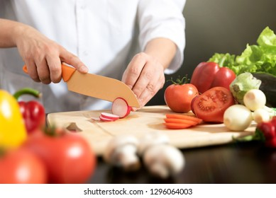 Chef prepares fresh vegetables. Cooking, healthy nutrition concept