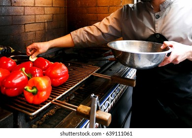 chef prepares red pepper on the grill