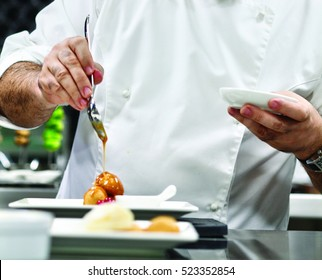 The chef prepares a special meal in the kitchen. Cooking techniques by chefs.