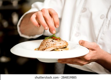 Chef is preparing appetizer on kitchen