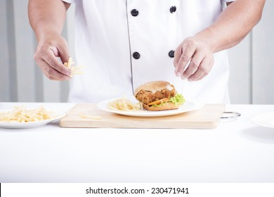 chef preparing a burger on the studio