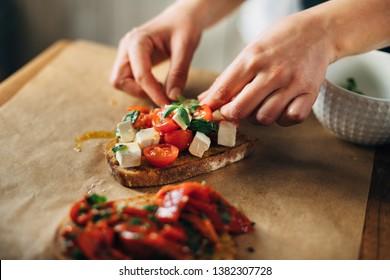 Chef preparing caprese bruschetta in the kitchen