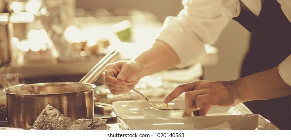 Chef preparing food, meal, in the kitchen, chef cooking in kitchen, Chef decorating dish, closeup, chef at work