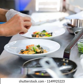 Chef preparing food, meal, in the kitchen, chef cooking, Chef decorating dish, closeup, chef at work