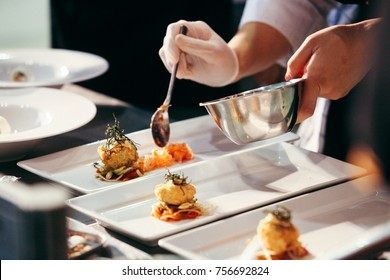 Chef preparing food, meal, in the kitchen, chef cooking in kitchen, Chef decorating dish, closeup