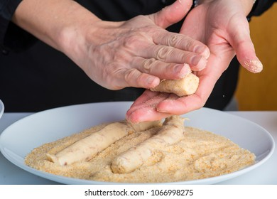 Chef preparing handmade croquettes in the kitchen