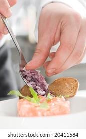 Chef preparing salmon salad