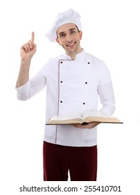 Chef with recipe book in hands isolated on white