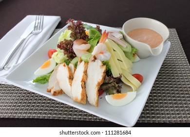 Chef salad cheese eggs vegetables baked chicken with sauce