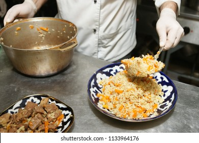 Chef is serving traditional Middle Eastern pilaf, commercial kitchen