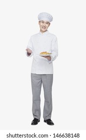 Chef showing prepared food, studio shot