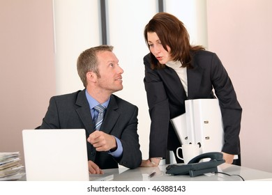 chef is showing the secretary something in the computer