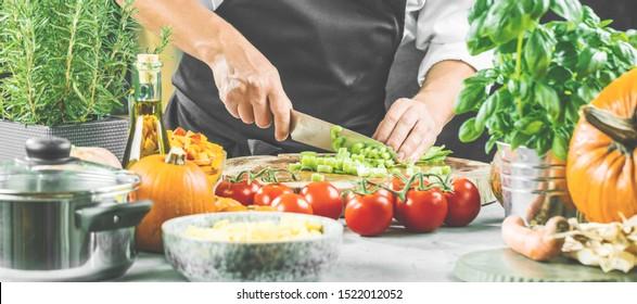 The chef slicing celery vegetables.