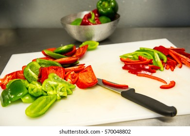Chef Slicing Peppers