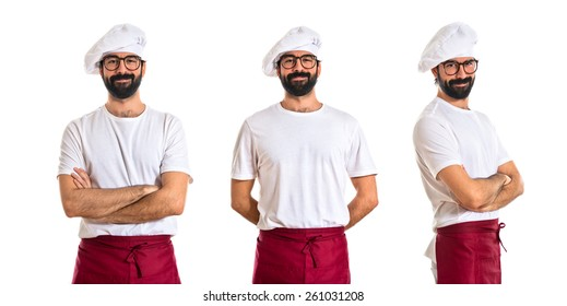 Chef smiling over white background