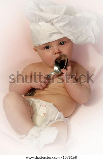chef - spoon eating newborn