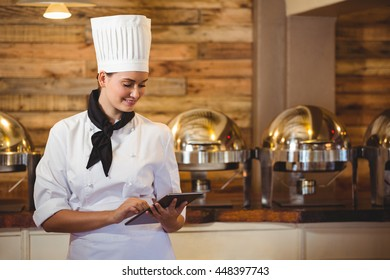 Chef standing with arms crossed in a restaurant