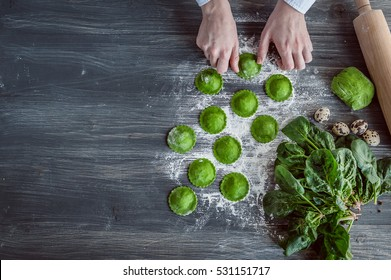 chef step by step, preparing a green ravioli with the addition of spinach dough, stuffed with ricotta and porcini mushrooms.