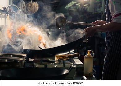 Chef is stirring vegetables  in wok