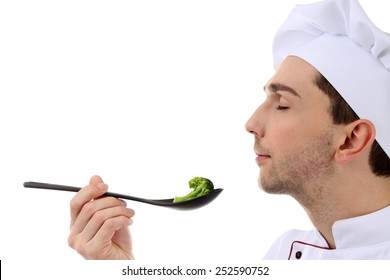 Chef tasting broccoli isolated on white