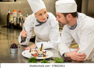 Chef teaching to adult cook