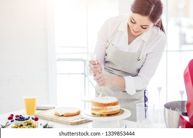chef using pastring bag while cooking, close up photo. copy space