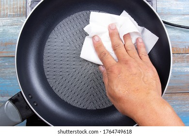 chef wiping the pan before cooking / bake parmesan cheese toast by pan concept