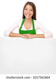 Chef woman business owner holding big white blank sign for copy space advertisment. Asian girl seller wearing green apron above on top of billboard.