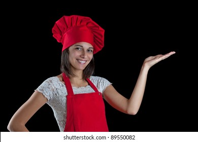 Chef woman. Isolated over black background.