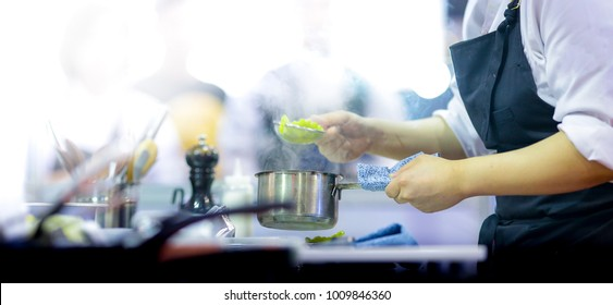 chef at work, Chef preparing food, meal, in the kitchen, chef cooking in kitchen, Chef decorating dish, closeup