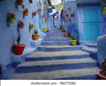 Chefchaouen Blue city in Marocco - colours flowers and vases