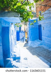 Chefchaouen blue town street in Morocco with beautiful arches and bright blue walls and soft focus. Close-up of an amazing city. Tourist point of Morocco