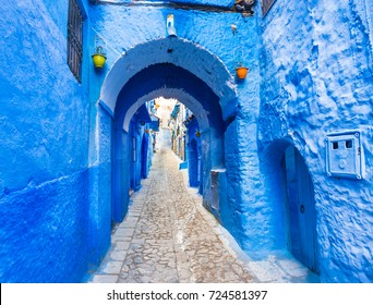 Chefchaouen blue town street in Morocco with beautiful arches and bright blue walls and soft focus