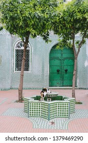 CHEFCHAOUEN, MOROCCO - CIRCA MAY 2018: A house with green tiled walls and a fountain in Chefchaouen, Morocco.