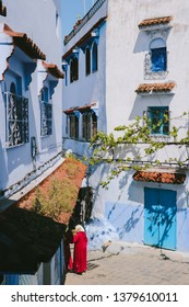 CHEFCHAOUEN, MOROCCO - CIRCA MAY 2018: Local women on the street in the medina of Chefchaouen, northwest Morocco. The town is famous for its buildings in shades of blue.