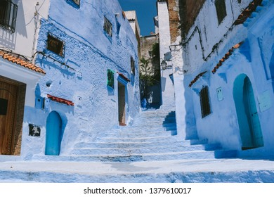 CHEFCHAOUEN, MOROCCO - CIRCA MAY 2018: An alley in the medina of Chefchaouen, northwest Morocco. The town is famous for its buildings in shades of blue.