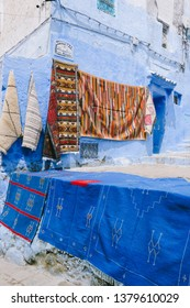 CHEFCHAOUEN, MOROCCO - CIRCA MAY 2018: Carpets and souvenirs sold in the medina of Chefchaouen, northwest Morocco. The town is famous for its buildings in shades of blue.