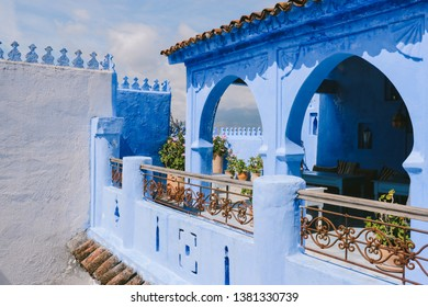 CHEFCHAOUEN, MOROCCO - CIRCA MAY 2018: Terrace of a house in the medina of Chefchaouen, northwest Morocco. The town is famous for its buildings in shades of blue.