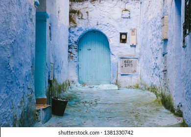 CHEFCHAOUEN, MOROCCO - CIRCA MAY 2018: A door in an alley in the medina of Chefchaouen, northwest Morocco. The town is famous for its buildings in shades of blue.