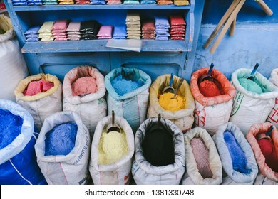 CHEFCHAOUEN, MOROCCO - CIRCA MAY 2018: Colorful pigments sold in the medina of Chefchaouen, northwest Morocco. The town is famous for its buildings in shades of blue.