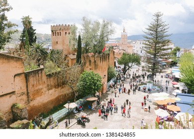 CHEFCHAOUEN, MOROCCO - CIRCA MAY 2018: The main square in the medina of Chefchaouen, with the kasbah on one side. The town is famous for its buildings in shades of blue.