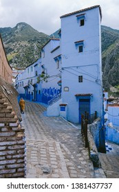 CHEFCHAOUEN, MOROCCO - CIRCA MAY 2018: On the street in the medina of Chefchaouen, northwest Morocco. The town is famous for its buildings in shades of blue.
