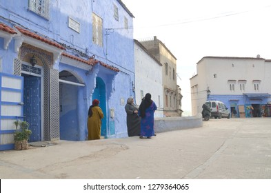 CHEFCHAOUEN, MOROCCO - JAN 11, 2019: few women chatting at the side of the road.
