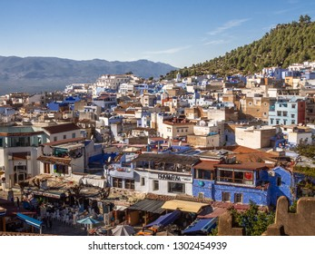 Chefchaouen, Morocco - January 15, 2019: Cityscape of Chefchaouen. View from the tower of Kasbah Castle. Houses of traditional architecture on the slope of the ridge of Er-Rif.