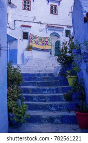 CHEFCHAOUEN, MOROCCO: May 20 2016: Quiet and narrow street in the Blue city of Chefchaouen, one of the touristy destinations of Morocco, Africa