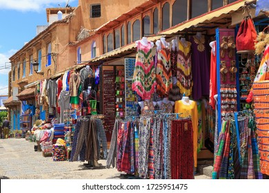 CHEFCHAOUEN, MOROCCO - MAY 29, 2017: Clothes stores in the center of Chaouen. The city is noted for its buildings in shades of blue and that makes Chefchaouen very attractive to visitors.