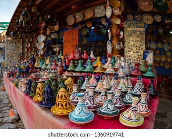 Chefchaouen. Morocco - October 12, 2018: Moroccan craftwork from a market stand. Tajines, plates, lamps, magnets, etc., are displayed waiting for a buyer.