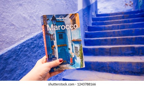 Chefchaouen, North Morocco / Africa. November 9th 2018 : best guide on the market for Morocco, Lonley planet.