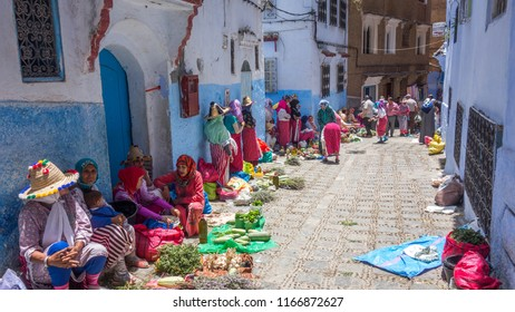 Chefchauen, Morocco; July 6, 2018. Berber women selling fruit and vegetables at the Chefchauen street market